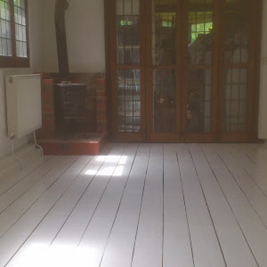 Floor sanded, gaps filled, floor painted and room decorated